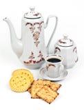 Kaffeeservice und Kaffee mit Biskuiten Stockfotos