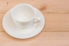 Kaffeetasse auf dem braunen backgroud Lizenzfreies Stockbild
