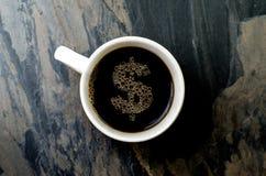Kaffeetasse: Dollarzeichen Stockfotografie