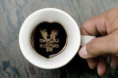 Kaffeetasse: ein Yensymbol Lizenzfreie Stockfotografie