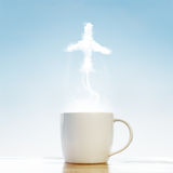 Kaffeetasse mit Flugzeugsymbol Stockbilder