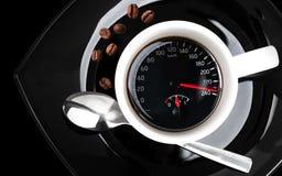Kaffeetasse mit Geschwindigkeitsmesser lizenzfreie stockfotos