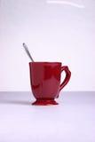 Kaffeetasse mit Löffel Stockfoto