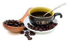 Kaffeetasse und Bohnen Stockfoto
