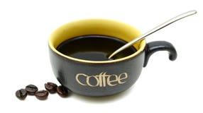 Kaffeetasse und Bohnen Lizenzfreie Stockfotografie