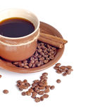 Kaffeetasse und Bohnenhintergrund Stockfotos