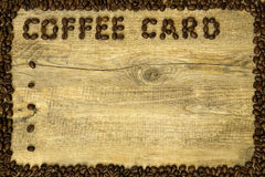 Kaffeetasse und Kaffeebohnen Lizenzfreies Stockfoto