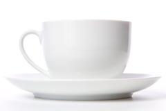 Kaffeetasse und Korn auf Weiß Lizenzfreies Stockbild
