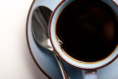 Kaffeetasse und Löffel Stockfotos