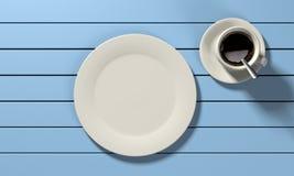 Kaffeetasse und leere Platte O Lizenzfreies Stockfoto
