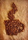 Kaffeetasse von den Kaffeebohnen Stockbilder