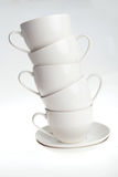 Kaffeetassen mit Saucers Lizenzfreie Stockfotos
