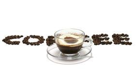 Kaffeewort mit Kaffeetasse Stockfotos