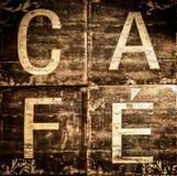 Kaffeezeichen auf braunem strukturiertem Hintergrund Stockfotografie