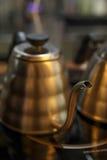 Kaffegarneringobjektet shoppar in bakgrundsdesign Royaltyfri Foto
