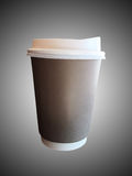 Kaffekopp över grå bakgrund arkivbild