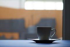 Kaffekopp i hem Arkivbilder