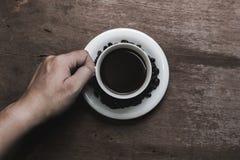 Kaffekopp med abstrakt begrepp Arkivfoto