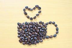 Kaffekopp med hjärta Arkivbild