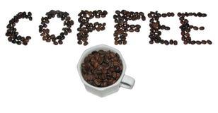 Kaffekopp och bönor Arkivfoto
