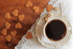 Kaffekopp och kakor Arkivbild
