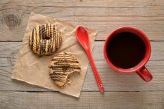 Kaffekopp och kakor Fotografering för Bildbyråer