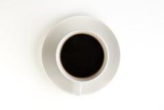 Kaffekopp på vit bakgrund Fotografering för Bildbyråer