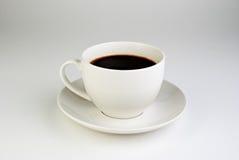 Kaffekopp på vit bakgrund Arkivbilder