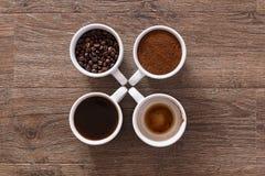 kaffekoppar fyra Fyra faser av kaffedrinken Fotografering för Bildbyråer