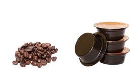 Kaffekorn och kapslar Arkivfoto
