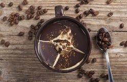 Kaffesemifreddoöken med kaffebönor Arkivfoto