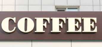 Kaffeskylt med brun bakgrund 1 Arkivfoton