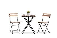 Kaffetabell med två stolar Royaltyfria Bilder