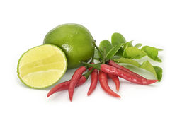 Kaffir leaves, limes and red Thai chilli on white backround. Kaffir Lime Leaves, limes and red Thai chilly on white background. herb and spicy ingredients for Royalty Free Stock Photography