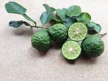 Kaffir Lime or Bergamot on plywood. Background Royalty Free Stock Photo