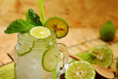 Kaffir lime So, Bergamot soda Cool drink, Thailand tradition Herb for Treatment of Acid Reflux, with Oriental Earth tone map backg. Round.Have some space for stock image