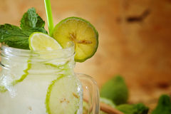 Kaffir lime So, Bergamot soda Cool drink, Thailand tradition Herb for Treatment of Acid Reflux, with Oriental Earth tone map backg. Round.Have some space for stock images