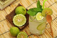 Kaffir lime So, Bergamot soda Cool drink, Thailand tradition Herb for Treatment of Acid Reflux, with Oriental Earth tone map backg stock image