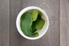 Kaffir lime leaf in white bowl Stock Images