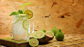 Free Kaffir Lime So, Bergamot Soda Cool Drink, Thailand Tradition Herb For Treatment Of Acid Reflux, With Oriental Earth Tone Map Backg Royalty Free Stock Image - 96904066