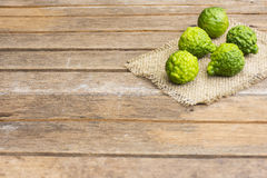 Kaffir lime on wooden table is fruits and leaves are used as a spice for thai food. And etc Stock Image