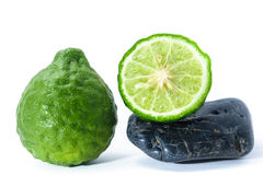 Kaffir Lime on Zen Stone, health and spa concept Stock Photo