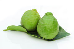 Kaffir Limes with leaf Royalty Free Stock Image