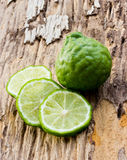 Kaffir limes on wood Stock Photo