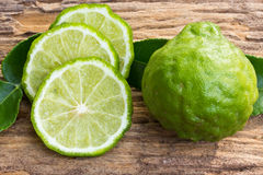 Kaffir limes on wood Stock Image