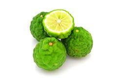 Kaffirlimefruktfrukter som isoleras på vit Fotografering för Bildbyråer