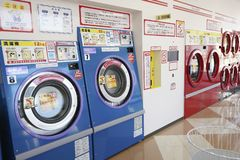 Row of industrial washing machines. KAGAWA, JAPAN - OCTOBER 29, 2018: Row of industrial washing machines in a public laundromat royalty free stock images