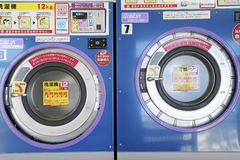Row of industrial washing machines. KAGAWA, JAPAN - OCTOBER 29, 2018: Row of industrial washing machines in a public laundromat stock photo