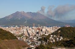 Kagoshima, Japan with Mount Sakurajima erupting Stock Image