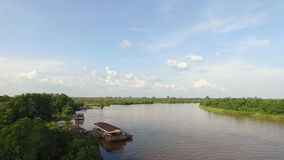 Kahayan Riverside, palangkaraya, Indonesia. Amazing view of kahayan river, with riverside village house, and green forest Royalty Free Stock Photography